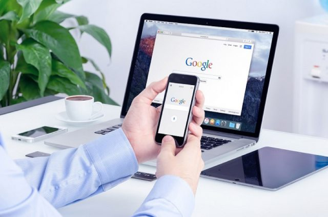 Google search on Apple iPhone screen and Macbook Pro display mul